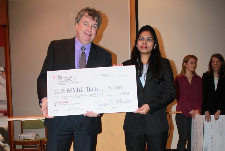 Madhura Mhatre, right, pictured with IUPUI Vice Chancellor for Research Simon Atkinson, won the $2,500 first-place prize at the JagStart competition. Photo courtesy of the IUPUI Office of the Vice Chancellor for Research