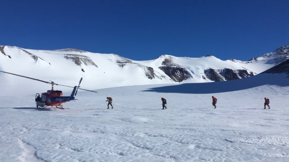 Kathy Licht, far right, walks with fellow researchers to a helicopter in Antarctica. Photo courtesy of Kathy Licht
