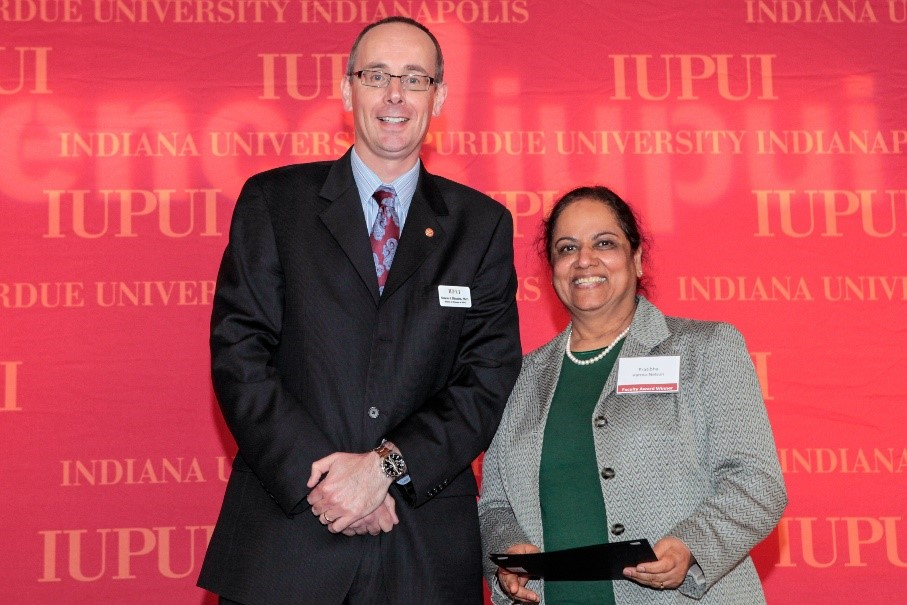 Purdue School of Science Dean Simon Rhodes(left) and Pratibha Varma-Nelson, Ph.D.