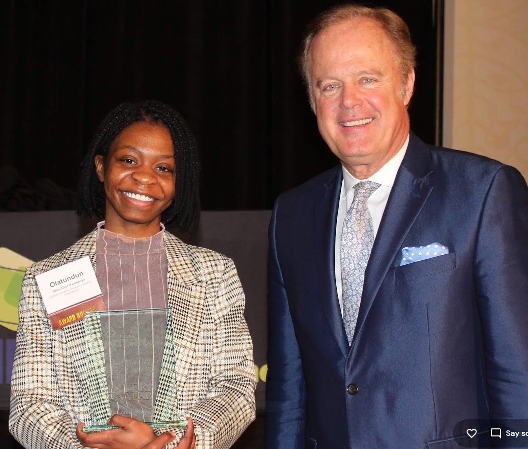 College Intern of the Year Olatundun Awosanya and INdiana Business Host Gerry Dick