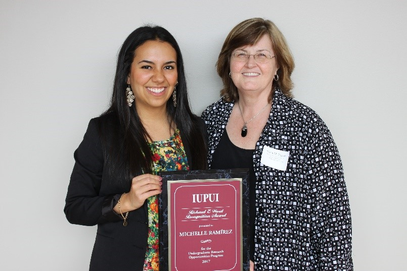 Image of Michelle Ramírez with faculty mentor Dr. Silvia Bigatti